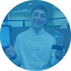 X3 Student Intern holding an award